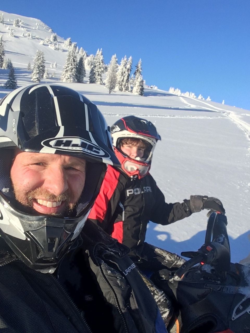 Father n Son Enjoying Sun and Snow