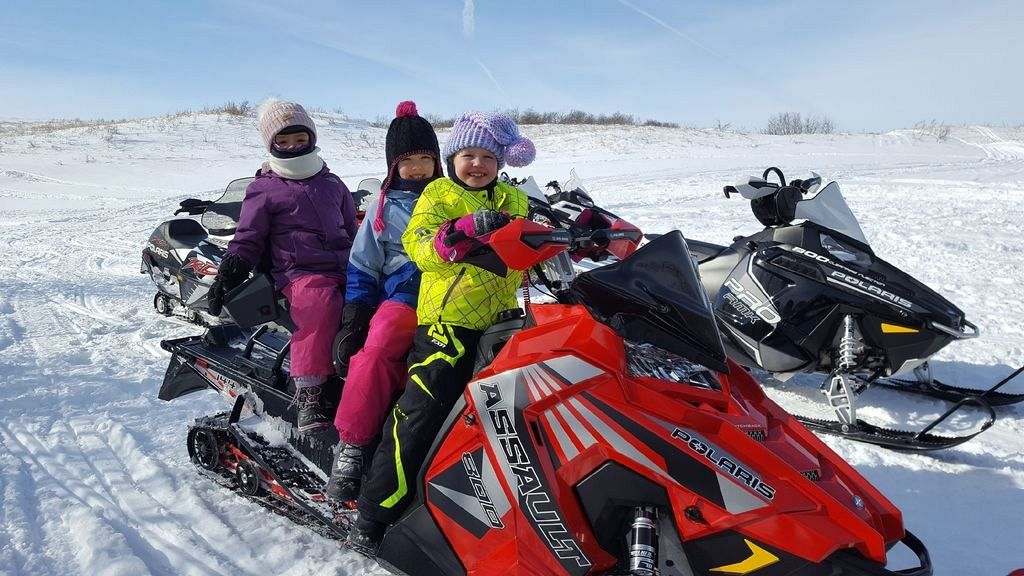 Giving the girls a ride on dad's sled!
