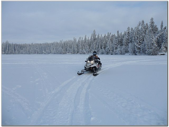 Snowmobiling on Little Bear Lake as well as trail riding on SSK Esker 208 Trail System