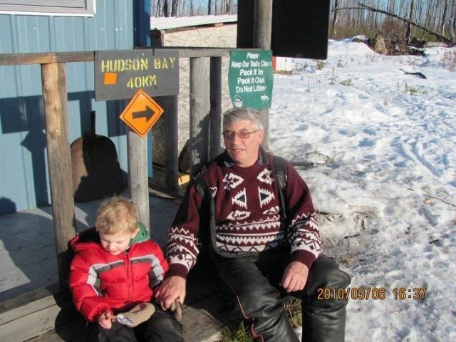 My son Brody age 2 1/2 at this time.   He loves going for snowmobile rides with his grandpa from Hudson Bay!  Here they are at Brody's favorite place...Larry's place warm up shack.  This photo was taken in  march 2010