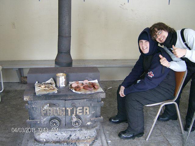 Enjoying a meal at Glen Bay Hut