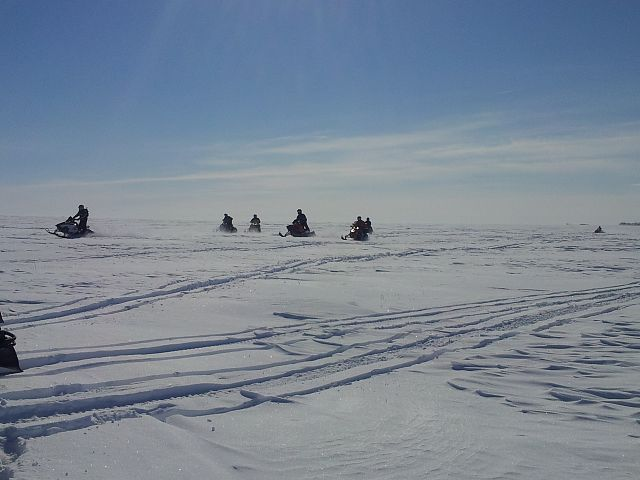 Another group of sledders having fun north of Indian Head SK-Typical Canola Field Scene in Saskatchewan!