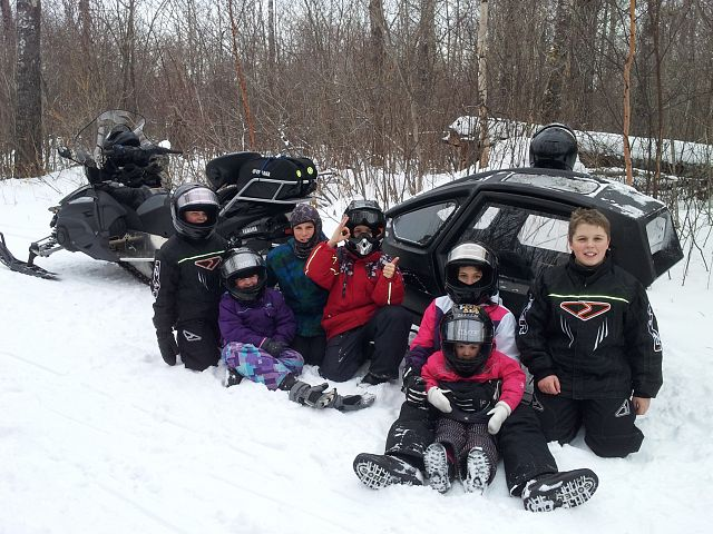 The kids enjoying a stop on the trail at Duck Mountain SK.
