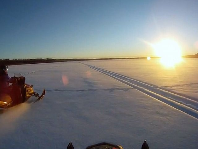 Taken with a Go Pro camera while riding into the sunset at Child's Lake in the Duck Mountains.