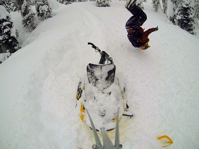 Stuck in the pow, might as well back flip into the fluff!