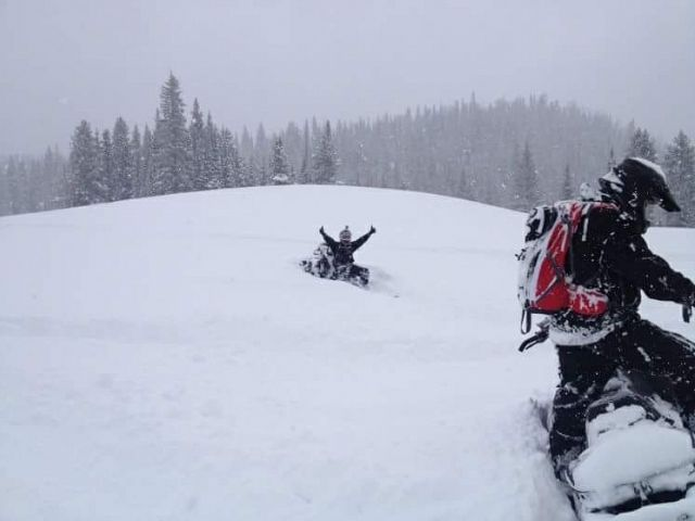 Hit a bump under the snow, got bucked off and stuck