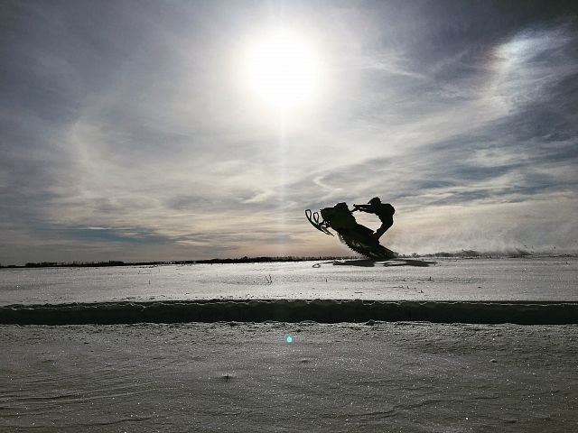 Enjoying a great day of sledding!