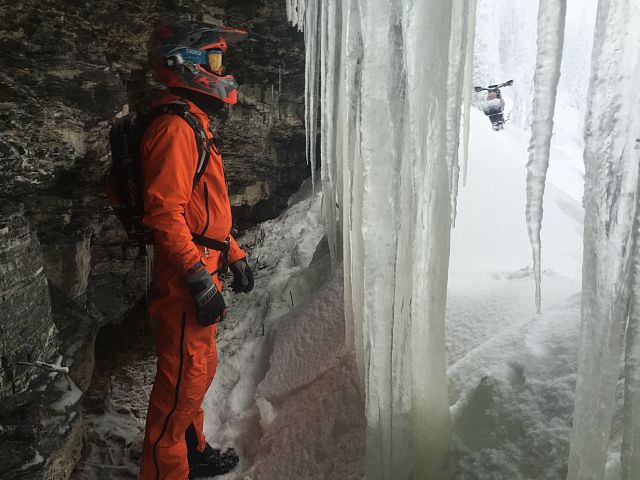 Keith Curtis taking a break in one of BCs ice waterfalls while on a Timbersled adventure