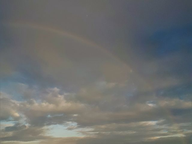 Snowmobiling in January with a rainbow overhead!