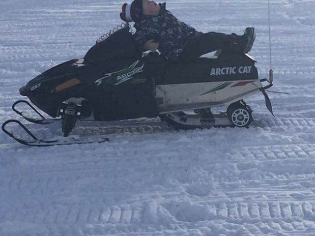 Our son chilling on his sled.