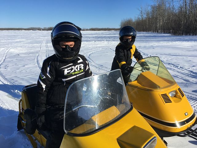 William & Alex Kozie makin' tracks on their vintage sleds.