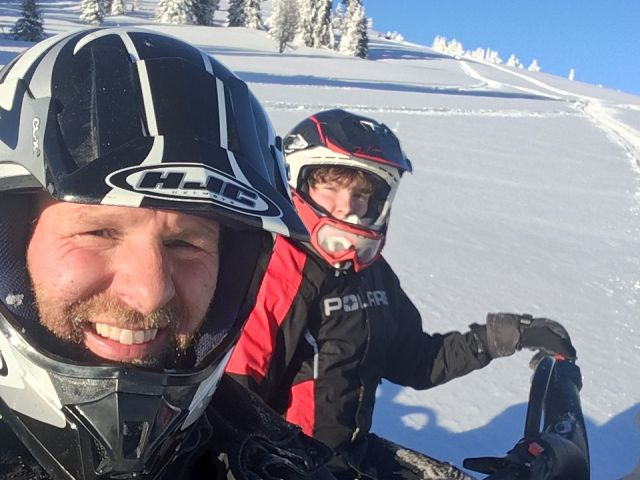 Father n Son Enjoying Sun and Snow