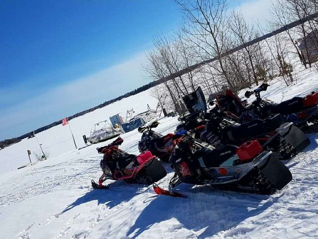 Sleds all ready to go for another excellent day of riding