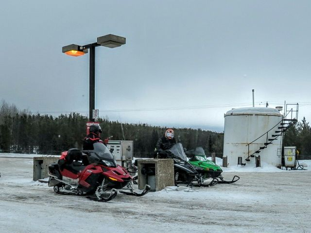 Gassing up at Caribou Creek Lodge Trail 208 J