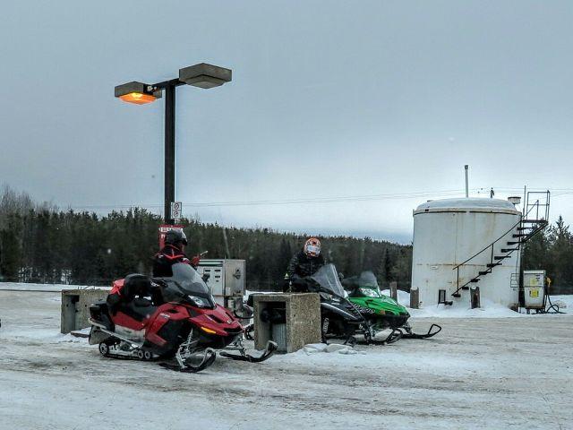 Gassing up at Caribou Creek Lodge Trail 208 J